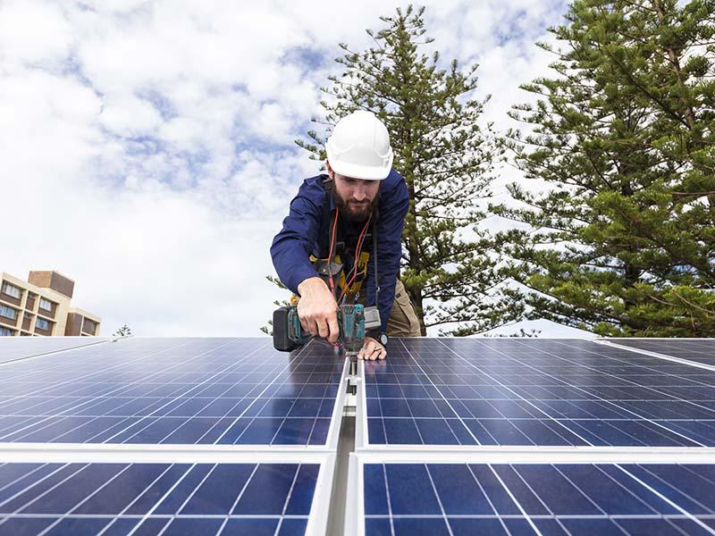 man-installing-solar