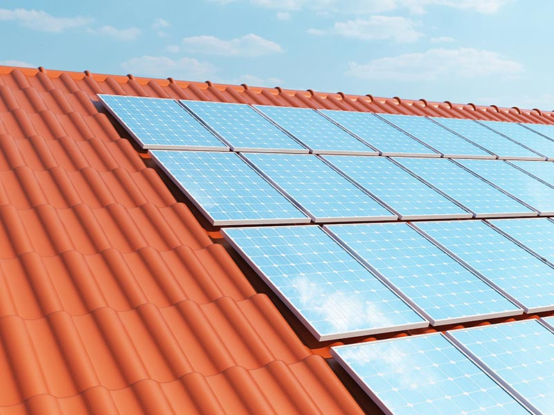 close up solar panels on red roof