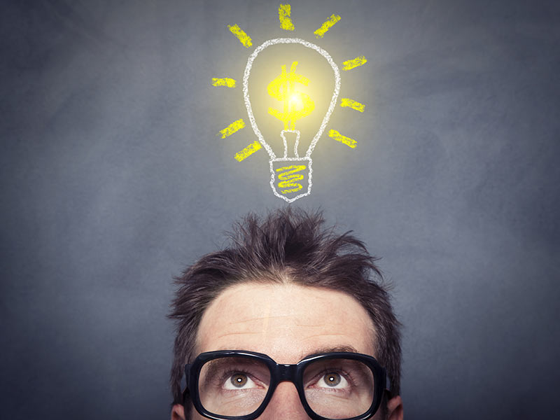 man looking at lightbulb above head