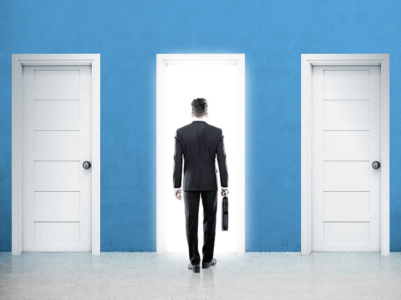 Man standing in front of 3 doors