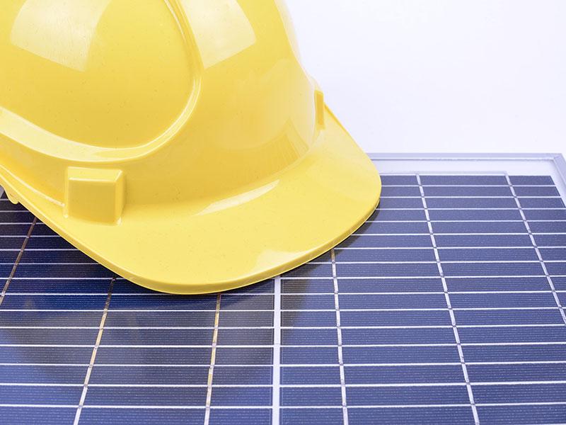 safety hat on solar panel