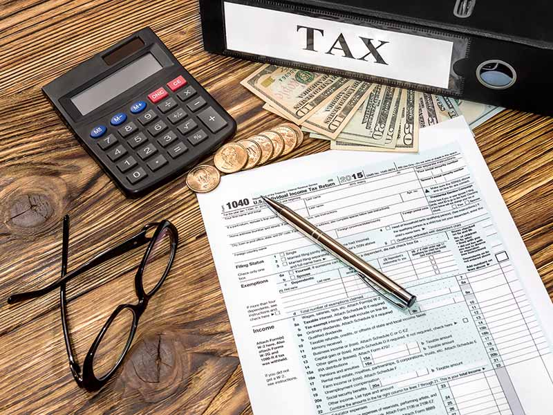 tax papers and money on desk