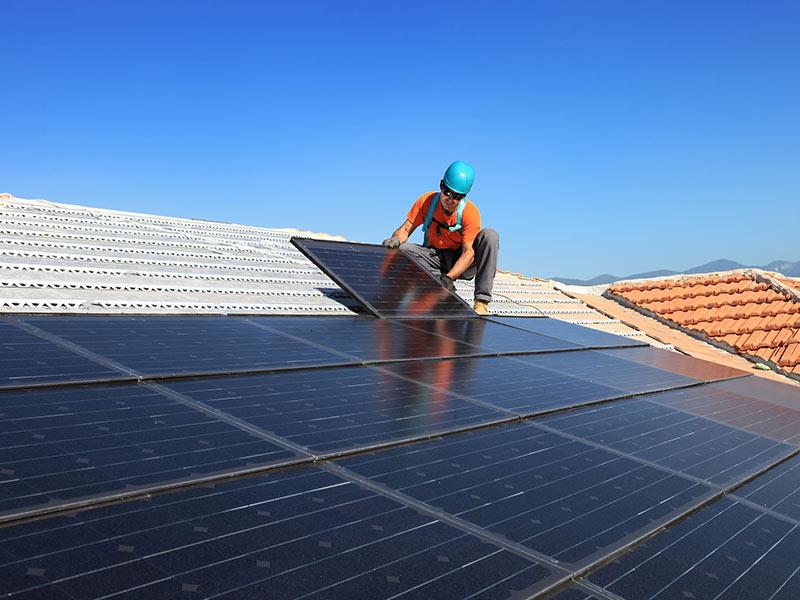 technician-installing-solar