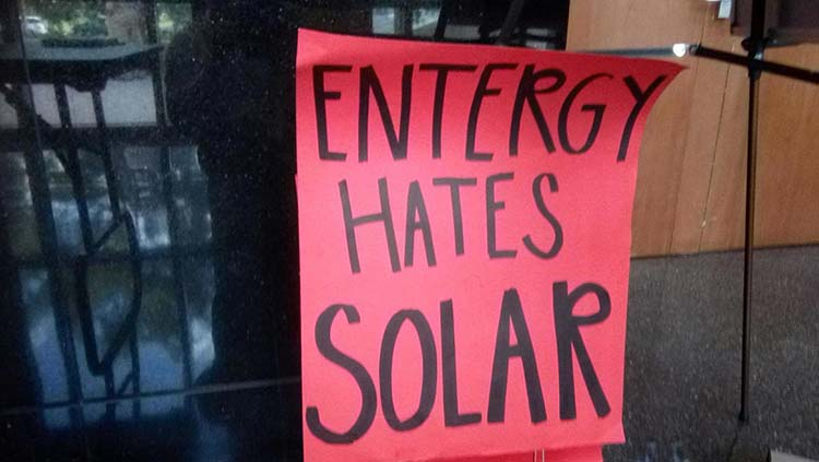 sign with writing says entergy hates solar