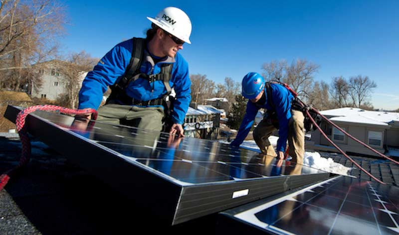 Installing solar. Courtesy SolarReviews